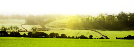 English landscape panamoric view across fields with sunrise photo