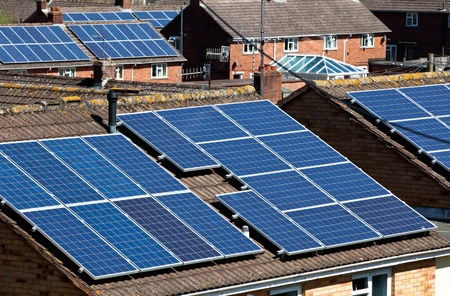 Solar Panels on many residential roofs photo