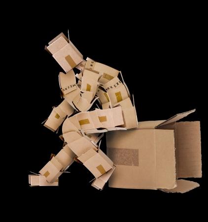 cajas de carton: Piense fuera de la caja de concepto sobre fondo negro Foto de archivo