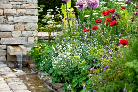 Garden flowers with stone walled stream photo