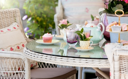 Afternoon tea and cakes in the garden photo