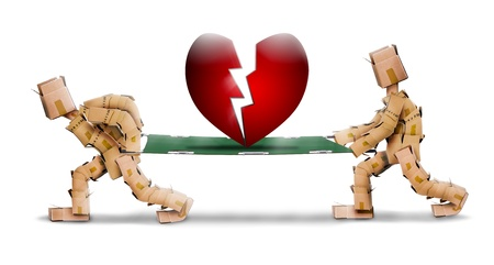 Broken heart carried on a stretcher by box men photo