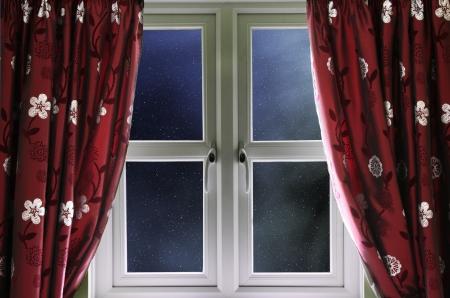 Starry night sky through a window