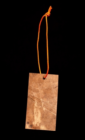 knotting: Brown paper label with orange string Stock Photo