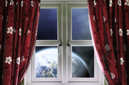 View of the Earth through a window with curtains photo