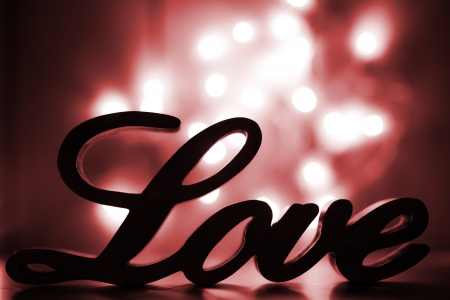 frendship: Love sign with red sparkle lights behind