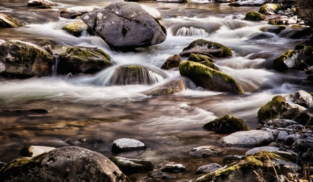 bedrock: River flowing over rocks with motion blur Stock Photo