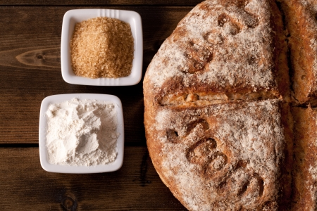 Rustic fresh bread with flour and sugar ingredients photo