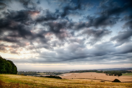 Beautiful skies over farmland hillside in the UK photo