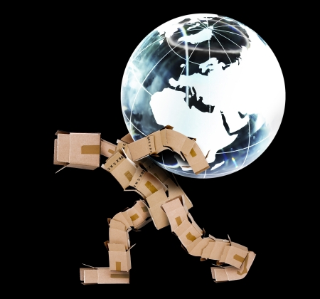 Box man carrying a globe on a black background Stock Photo