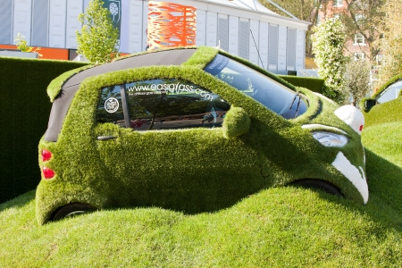 show garden: LONDON - MAY 2012 - RHS CHELSEA FLOWER SHOW: The Chelsea Flower Show has been running since 1862. The EasiGrass Easibug car showing artificial grass is part of the gold award winning Best Fresh Garden entry.