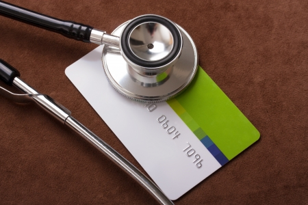 credit report: Stethoscope on a credit card
