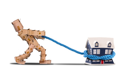 removals: Box character pulling a house with a rope on a white background
