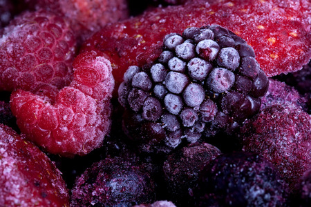 summer pudding: Frozen summer fruits macro close up with blackberries raspberries and strawberry