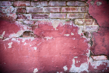 masonary: Decaying wall grunge texture. Red paint and exposed brick with plaster falling off Stock Photo