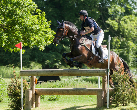 salto de valla: HOUGHTON, NORFOLKENGLAND - May 27th 2017: Houghton International Horse Trials 2017 Greg Kinsella riding Watermill Rocks. Including cross country, eventing, show jumping and dressage at the top level