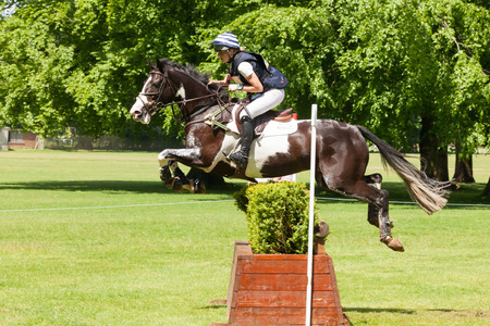 martha: HOUGHTON, NORFOLKENGLAND - May 27th 2017: Houghton International Horse Trials 2017 Martha Craggs riding Corbett. Including cross country, eventing, show jumping and dressage at the top level
