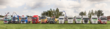 NORFOLK, UK - AUGUST 19th, 2017: Truckfest Norwich is a transport festival in the UK based around the haulage industry located in Norfolk. Including trade stands and shows like Monster Truck car crushing & stunt driving. Truck lineup in showground.