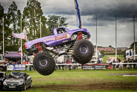 NORFOLK, UK - AUGUST 19th, 2017: Truckfest Norwich is a transport festival. Monster Truck big air jump over crushed cars