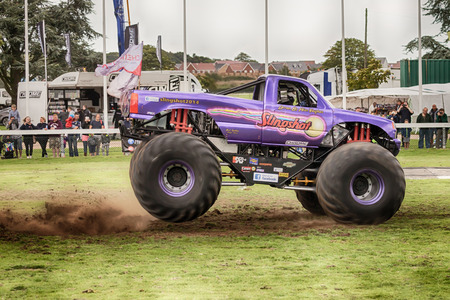 NORFOLK, UK - AUGUST 19th, 2017: Truckfest Norwich is a transport festival in the UK based around the haulage industry located in Norfolk. Including Monster Truck Slingshot driven by Alan Vaughan
