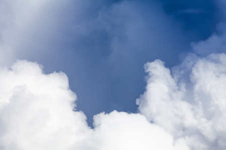 Big white puffy clouds and blue sky background. Dramatic hight detail weather pattern and textures