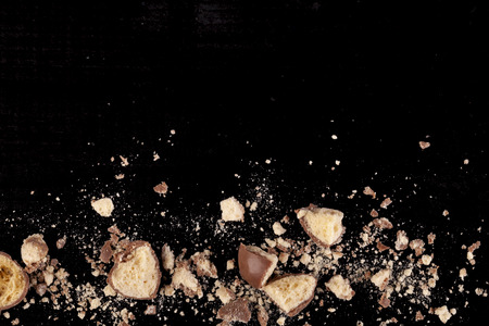 Chocolate honeycomb crumbs with bit and peices broken up on the bottom of teh image