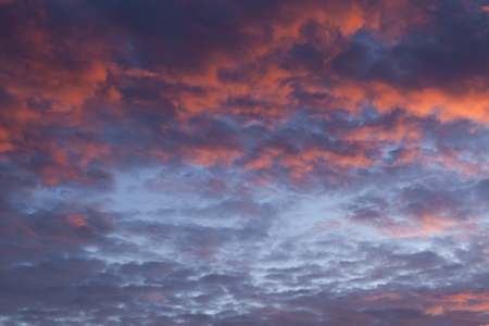Dramatic pink sunset cloudscape with a little blue sky poking through Reklamní fotografie