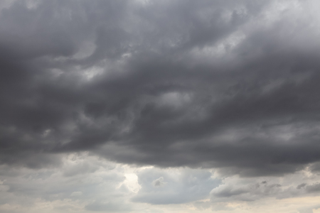 Stormy skies with grey clouds. Natural weather background showing possible rain Reklamní fotografie
