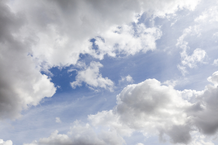 White summer clouds in a blue sky background