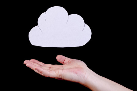 Cloud computing, identity theft and data protection concept. Cloud cutout with a human open hand underneath the cloud. Reklamní fotografie