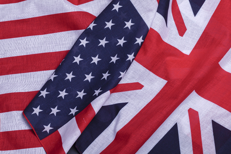 Two flags English union jack and USA star spangled banner. Material symbols of first world countries