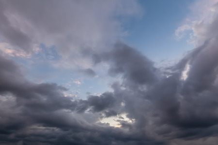 Unusual cloudy skies with dramatic grey clouds with some blue sky. Reklamní fotografie