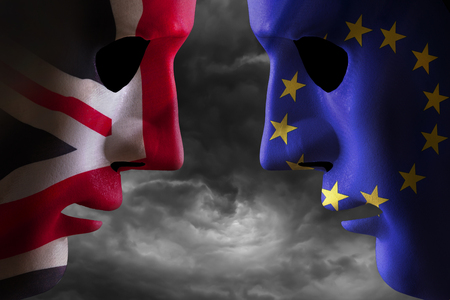 Brexit concept showing two heads together covered in EU flag and UK flag with storm clouds behind. Political graphic concept artwork. Reklamní fotografie