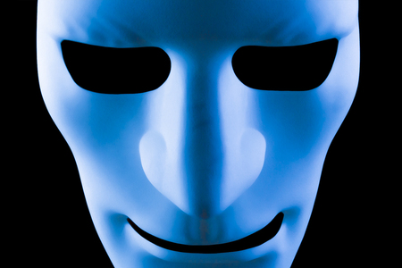 Blue face mask artificial intelligence concept close up on a black background