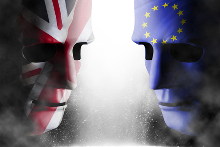 Brexit concept with two head to head human faces covered with UK (united Kingdom) flag and EU (European Union) flag. Steam and smoke surrounds the symbolic policital graphics.