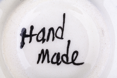 Hand made sign on the bottom of a dish Reklamní fotografie