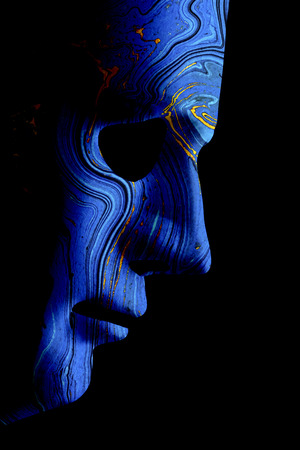 Robot blue face mask side view close up with contoured textured skin and blank eyes. Black background and space for text. Artificial intelligence concept in a human form