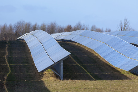 Solar panels farm photovoltaic modules installed in a large area for commercial green energy supply to the national grid, UK.