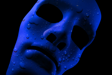 Blank robot face with blue water texture for skin. AI concept with close up human like features. Black background.