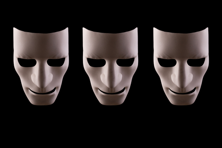 Three blank robotic faces on a black background. Artificial intelligence working together concept. Reklamní fotografie