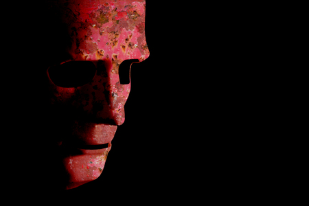 Old robotic decaying face mask. Rusty red grunge texture on a black background with copy space.
