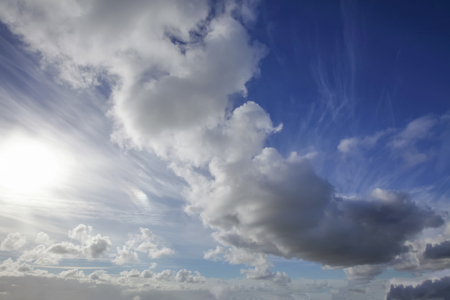 Beautiful skies with white clouds and sunshine. Blue sky and heavenly sunlight nature background