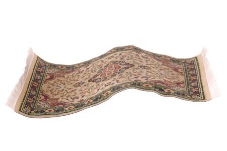Magic carpet flying in the air, isolated in a white bacground