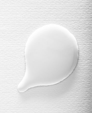 White paint textured bubble on a white background. Abstract wet liquid speech bubble shape