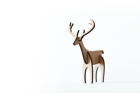 Single reindeer cardboard toy isolated on a white background. Christmas icon with Text space