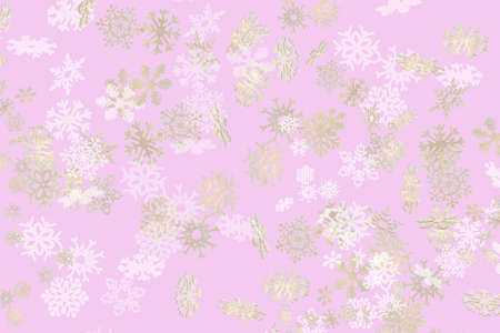 Beautiful snowflake pattern white and gold falling on a subtle pastel pink background 免版税图像