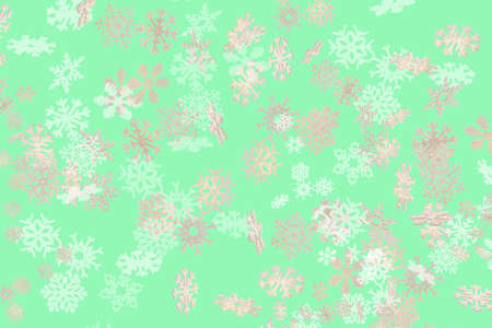 Beautiful snowflake pattern white and gold falling on a subtle pastel green background 免版税图像