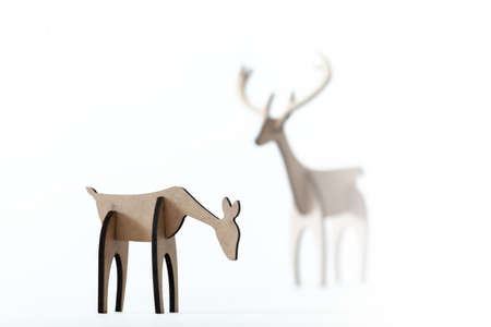Reindeer stag and young deer cardboard toy isolated on a white background. Christmas icon and shapes with text space