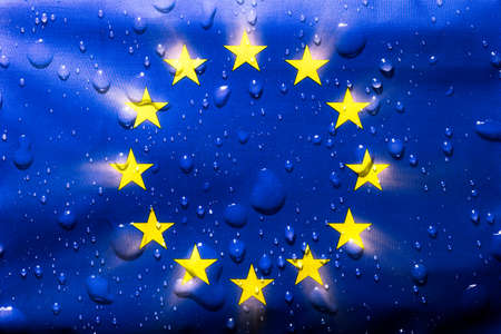 Eurpoean Union flag with water droplets on. EU national symbol for a patriotic group of countries adopted 1955