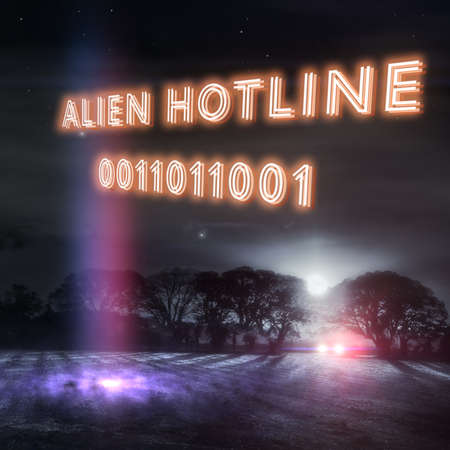 """""""Alien Hotline"""" slogan with UFO landing lights and a car headlights in a dark winters night field. Part of a series of fun UFO designs by Simon Bratt Photography. Nobody was reported abducted in the making of this scene. Social distancing was observed."""